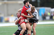 Richard Whiting (L)  and Gary Wheeler (R) of Toronto Wolfpack  tackles Rhys Williams (C) of London Broncos during the Super 8s Qualifiers Million Pound Game at Lamport Stadium, Toronto, Canada<br /> Picture by Stephen Gaunt/Focus Images Ltd +447904 833202<br /> 07/10/2018