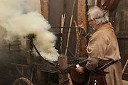 Scene of a blacksmith at work in the Middle Ages. Image taken from the filming of 'Paris la ville a remonter le temps' written by Carlo de Boutiny and Alain Zenou, directed by Xavier Lefebvre, a Gedeon Programmes production. Picture by Manuel Cohen