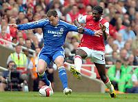 Photo: Ed Godden/Sportsbeat Images.<br /> Arsenal v Chelsea. The Barclays Premiership. 06/05/2007.<br /> Arsenal's Emmanuel Adebayor (R), is held off the ball by Chelsea's Wayne Bridge.