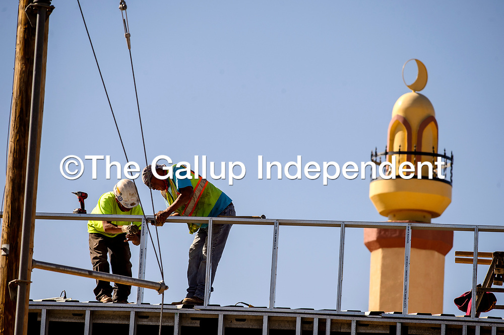 Builders work on the framing of a new addition to the Gallup Islamic Center in Gallup Monday.