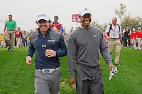 Rory McIlroy of Northern Ireland and Tiger Woods of USA have a laugh as they walk down the fairway together during the Duel at Jinsha Lake at the Golf Villa Jinsha Lake on October 29, 2012 in Zhengzhou, China. McIlroy beat Woods by a single stroke shooting a 67 to Wood's 68.  Photograph by David Paul Morris