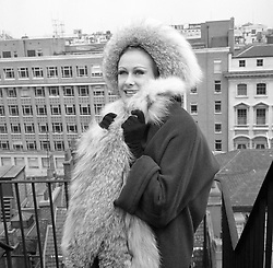 Aldine Honey from South Africa models a three-quarter length angora coat trimmed with lynx fur and matching hat during rehearsals in London for the Fifth London Fashion Week, opening tomorrow.