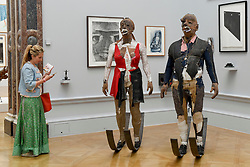 """© Licensed to London News Pictures. 08/06/2017. London, UK. A visitor views a sculpture called """"Defending Integrity From The Power That Be"""" by Tim Shaw RA (GBP60,000). Preview of the Summer Exhibition 2017 at the Royal Academy of Arts in Piccadilly.  Co-ordinated by Royal Academician Eileen Cooper, the 249th Summer Exhibition is the world's largest open submission exhibition with around 1,100 works on display by high profile and up and coming artists.<br />  Photo credit : Stephen Chung/LNP"""