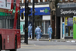 © Licensed to London News Pictures. 03/02/2020. London, UK. Forensic officers on Streatham High Road where 20 year old, Sudesh Amman was shot by police after he stabbed people on Sunday 2 February. Sudesh Amman was released last week after serving half of his sentence of three years and four months for terror offences and was under police surveillance at the time of the attack on Streatham High Road. Metropolitan Police declared the incident as a terrorist-related.  Photo credit: Dinendra Haria/LNP