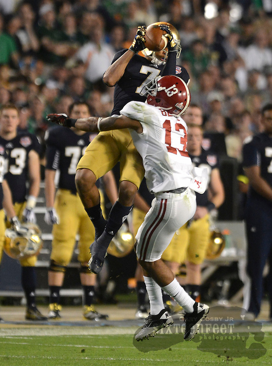 Daily Photo by Gary Cosby Jr.   Notre Dame wide receiver TJ Jones makes a catch over Alabama defensive back Deion Belue (13) during the first half of the BCS National Championship Game in Sun Life Stadium Monday, January 7, 2013.