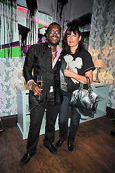 ORLANDO HAMILTON and his wife at the launch of Quintessentially Soho at the House of St Barnabas, 1 Greek Street, London on 29th September 2009.<br /> <br /> <br /> <br /> <br /> BYLINE MUST READ: donfeatures.com<br /> <br /> *THIS IMAGE IS STRICTLY FOR PAPER, MAGAZINE AND TV USE ONLY - NO WEB ALLOWED USAGE UNLESS PREVIOUSLY AGREED. PLEASE TELEPHONE 07092 235465 FOR THE UK OFFICE.*
