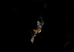 A migrant eats a biscuit on the Migrant Offshore Aid Station (MOAS) ship Topaz Responder after being rescued around 20 nautical miles off the coast of Libya, June 23, 2016.  Picture taken June 23, 2016.<br /> REUTERS/Darrin Zammit Lupi <br /> MALTA OUT. NO COMMERCIAL OR EDITORIAL SALES IN MALTA