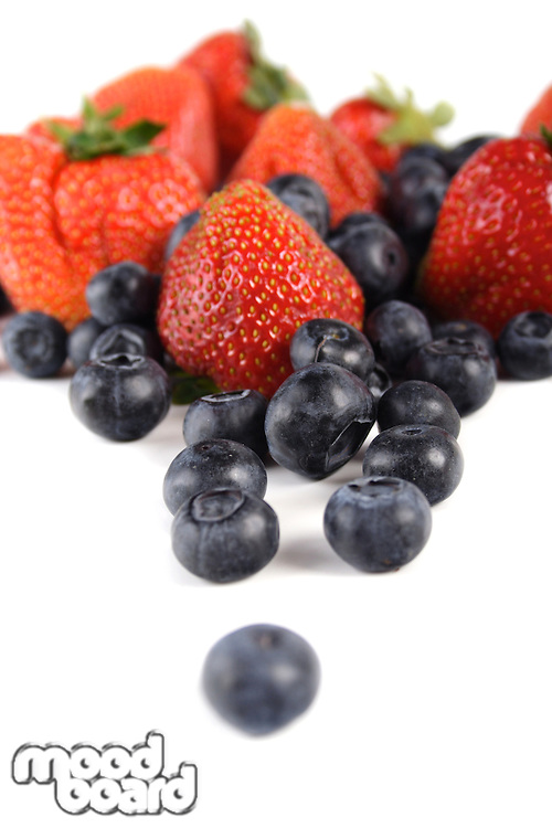 Studio shot of blueberries and strawberries