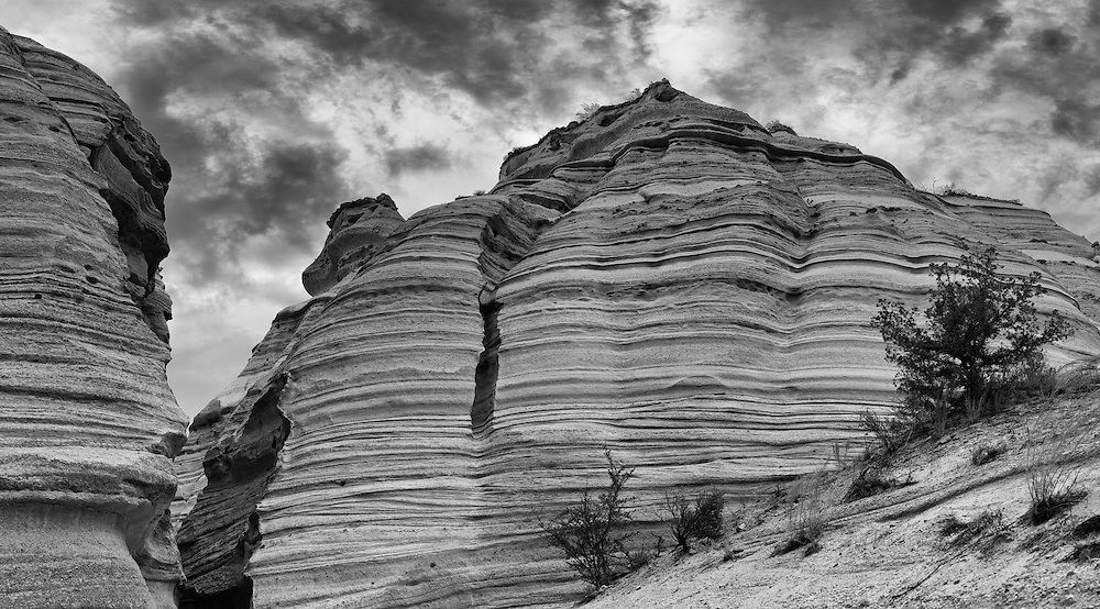 Kasha-Katuwe Tent Rocks National Monument, located 40 miles southwest of Santa Fe, New Mexico. The area owes its remarkable geology to layers of volcanic rock and ash deposited by pyroclastic flow from a volcanic explosion within the Jemez Volcanic Field that occurred 6 to 7 million years ago.