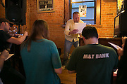 Ryan Schofield runs a trivia competition every Wednesday at Scotland Yard Pub in Rochester on Wednesday, May 6, 2015.