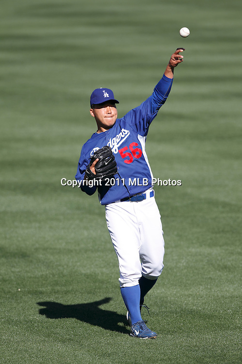 LOS ANGELES, CA - APRIL 15:  Pitcher Hong-Chih Kuo #56 of the Los Angeles Dodgers throws a pitch while playing catch before the game between the St. Louis Cardinals and the Los Angeles Dodgers on Friday April 15, 2011 at Dodger Stadium in Los Angeles, California. (Photo by Paul Spinelli/MLB Photos via Getty Images) *** Local Caption *** Hong-Chih Kuo
