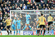 Bolton Wanderers striker Gary Madine (14) clears a shot with a header during the EFL Sky Bet League 1 match between Milton Keynes Dons and Bolton Wanderers at stadium:mk, Milton Keynes, England on 4 February 2017. Photo by Dennis Goodwin.