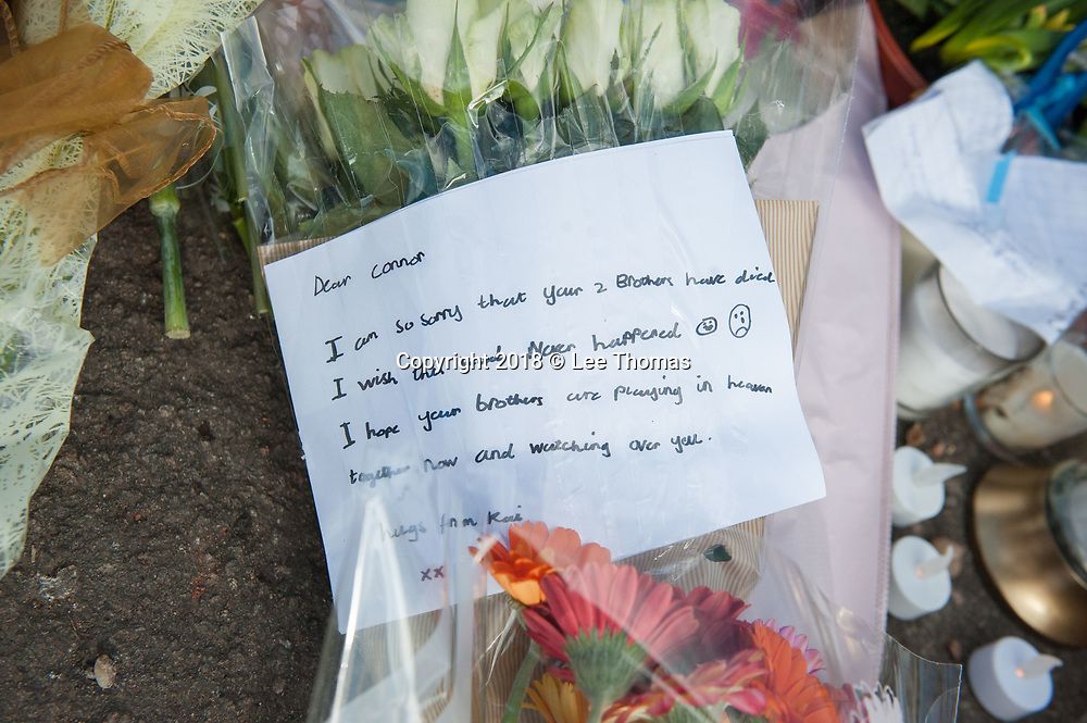 Longfellow Road, Stoke, Coventry, UK. 23rd February 2018. Floral tributes and messages of condolence are placed near the spot where two boys were killed by car in Coventry yesterday. The two brothers aged six and two died after a hit-and-run crash in the Stoke area of Coventry. /  Pictured: Floral tributes and messages left at the crash scene. // Lee Thomas, Tel. 07784142973. Email: leepthomas@gmail.com  www.leept.co.uk (0000635435)