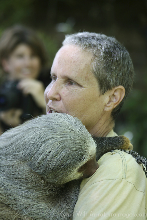 Central America, Latin America, Costa Rica.  Wildlife rehabilitator Carol Crews educates guests at the Cana Blanca Wildlife Sanctuary and Animal Rehabilitation Center.