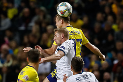 November 20, 2018 - Stockholm, Sweden - Viktor Claesson (top) of Sweden and Yury Gazinsky of Russia vie for a header during the UEFA Nations League B Group 2 match between Sweden and Russia on November 20, 2018 at Friends Arena in Stockholm, Sweden. (Credit Image: © Mike Kireev/NurPhoto via ZUMA Press)