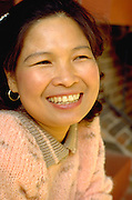 Smiling Cambodian woman age 35 sending son to Boy Scout camp.  St Paul  Minnesota USA