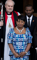 © London News Pictures. 22/04/2013. London, UK.  L to R - Bishop of London RICHARD CHARTRES, DOREEN LAWRENCE and STUART LAWRENCE  pose for photographers outside St Martins in the Field Church in London following a memorial service to mark the 20 anniversary of the murder of Stephen Lawrence. Stephen Lawrence was murdered in a racist attack while waiting for a bus in SOuth London on the evening of 22 April 1993. Photo credit : Ben Cawthra/LNP