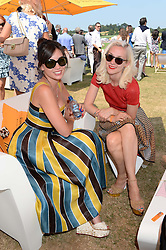 Left to right, DAISY LOWE and PORTIA FREEMAN at the Veuve Clicquot Gold Cup, Cowdray Park, Midhurst, West Sussex on 21st July 2013.