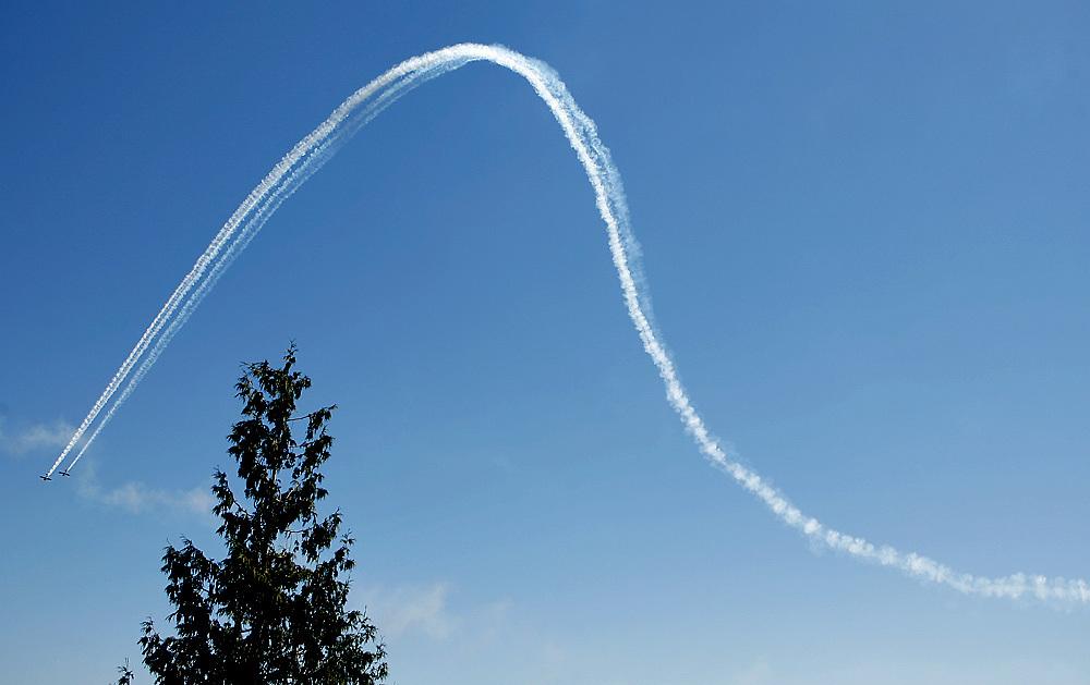 Lt. Col. John Klatt of the Air National Guard and Bill Stein display their aerobatic skills in 2010.