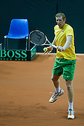 Chris Guccione from Australia in action while men's double during the BNP Paribas Davis Cup 2013 between Poland and Australia at Torwar Hall in Warsaw on September 14, 2013.<br /> <br /> Poland, Warsaw, September 14, 2013<br /> <br /> Picture also available in RAW (NEF) or TIFF format on special request.<br /> <br /> For editorial use only. Any commercial or promotional use requires permission.<br /> <br /> Photo by &copy; Adam Nurkiewicz / Mediasport