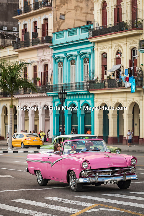 Havana, Cuba, November 2018. Time seems to have stopped in the 1950's in Havana, Cuba's capital city. Cuba is a Caribbean island nation under communist rule. It has sugar-white beaches and is dotted with tobacco fields, which play a part in the production of the country's legendary cigars. The capital, Havana, is lined with pastel houses, 1950s-era cars and Spanish-colonial architecture in the 16th-century core. Photo by Frits Meyst / MeystPhoto.com