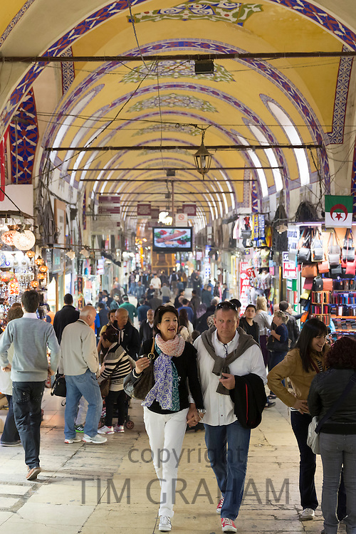 Western tourists shopping in The Grand Bazaar, Kapalicarsi, great market in Beyazi, Istanbul, Republic of Turkey