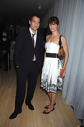 CLIVE OWEN and HELENA CHRISTENSEN at an Evening at Sanderson in Aid of CLIC Sargent held at The Sanderson Hotel, 50 Berners Street, London W1 on 15th May 2007.<br />