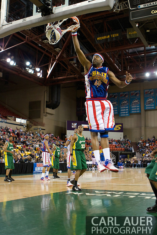 April 30th, 2010 - Anchorage, Alaska:  Globetrotter Hawk (43) elevates in the lane for a slam dunk during their Friday night game at the Sullivan Arena.