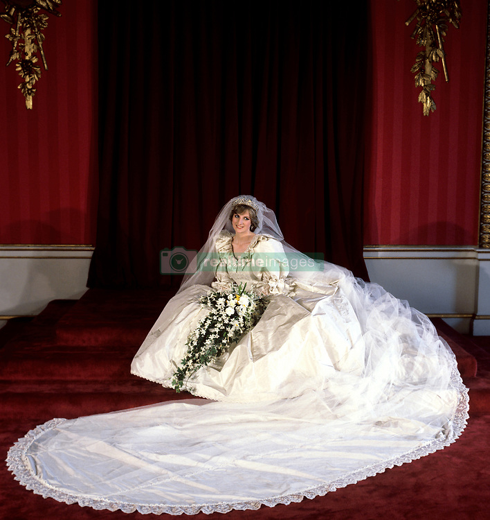 The Princess of Wales seated in her bridal gown at Buckingham Palace after her marriage to Prince Charles at St. Paul's Cathedral.