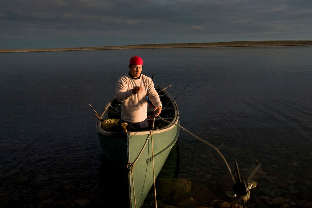 NHL player Jordin Tootoo anchors his boat after midnight in the summer light only a 100 miles from the Arctic Circle. Photographed for Sports Illustrated.