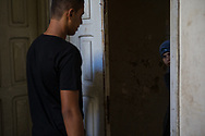 Rafaat's daughter, Rokaca, answers the door as her brother returns home in Damour, Lebanon on Sunday, June 8, 2014. <br /> <br /> Since the alledged attempts on their lives and kidnapping of Doread following the death of their mother and brother, the family has lived in constant fear.