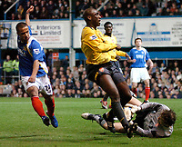 Photo: Ed Godden.<br />Portsmouth v Arsenal. The Barclays Premiership. 12/04/2006. Wayne Routledge (L) sees his shot saved by the Arsenal keeper, Jens Lehmann.