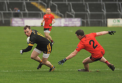 Louisburgh&rsquo;s Kevin Gibbons gets round Glenbeigh&rsquo;s Stephen O&rsquo;Sullivan.<br />