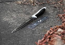 © Licensed to London News Pictures. 05/08/2018. LONDON, UK. A knife found in Norbiton Avenue, close to the police cordon in Cambridge Gardens, Kingston-Upon-Thames.  A murder investigation has been launched after a man in his 20s was fatally stabbed in Cambridge Gardens in the early hours of Sunday morning.   Investigations are ongoing  It is not known whether the knife found in Norbiton Avenue is related to the murder investgation.  Photo credit: Stephen Chung/LNP
