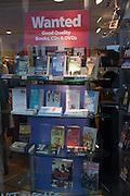 Charity shop window display of books