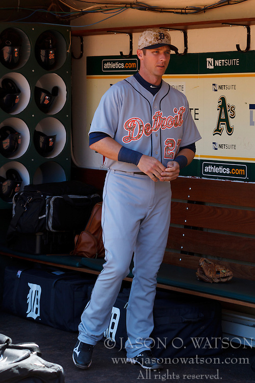 OAKLAND, CA - MAY 26:  Andrew Romine #27 of the Detroit Tigers stands in the dugout before the game against the Oakland Athletics at O.co Coliseum on May 26, 2014 in Oakland, California. The Oakland Athletics defeated the Detroit Tigers 10-0.  (Photo by Jason O. Watson/Getty Images) *** Local Caption *** Andrew Romine