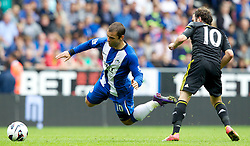 WIGAN, ENGLAND - Sunday, August 19, 2012: Chelsea's Juan Mata in action against Wigan Athletic's Shaun Maloney during the Premiership match at the DW Stadium. (Pic by Vegard Grott/Propaganda)