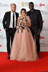 Caroline Flack, with Chris Hughes and Marcel Somerville, holding the BAFTA award for Reality and Constructed Factual for Love Island at the Virgin TV British Academy Television Awards 2018 held at the Royal Festival Hall, Southbank Centre, London.