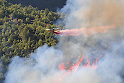 Fire retardant is dropped from planes as a huge forest fire rages on the Carmel Mountain South of Haifa Israel. International efforts to contain the fire have been going on for the last 3 days. December 4th 2010 Plane .