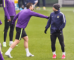 Manchester City's Frank Lampard shares a joke with Sergio Aguero during the training session at the Etihad Campus ahead of the UEFA Champions League second leg match against FC Barcelona - Photo mandatory by-line: Matt McNulty/JMP - Mobile: 07966 386802 - 17/03/2015 - SPORT - Football - Manchester - Etihad Campus - Barcelona v Manchester City - UEFA Champions League