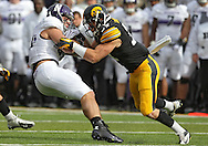 October 26 2013: Northwestern Wildcats fullback Dan Vitale (40) is hit by Iowa Hawkeyes defensive back John Lowdermilk (37) during the second quarter of the NCAA football game between the Northwestern Wildcats and the Iowa Hawkeyes at Kinnick Stadium in Iowa City, Iowa on October 26, 2013.