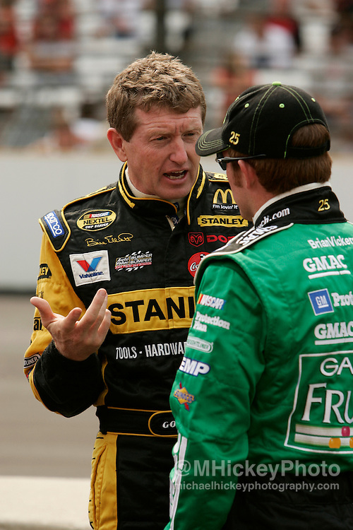 Bill Elliott talks to Brian Vickers on pit road before qualifications for the Allstate 400 at the Brickyard.