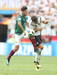 MOSCOW, June 17, 2018  Mats Hummels (R) of Germany vies with Carlos Vela of Mexico during a group F match between Germany and Mexico at the 2018 FIFA World Cup in Moscow, Russia, June 17, 2018. (Credit Image: © Xu Zijian/Xinhua via ZUMA Wire)