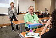 Scott Littlefield, of Shiloh Industries, discusses why he believes a pool noodle represents flexibility during a breakout session led by Lisa George, left, the Vice President of International Talent for Walmart, during the College of Business Center for Leadership Event in Copeland Hall on April 23, 2016
