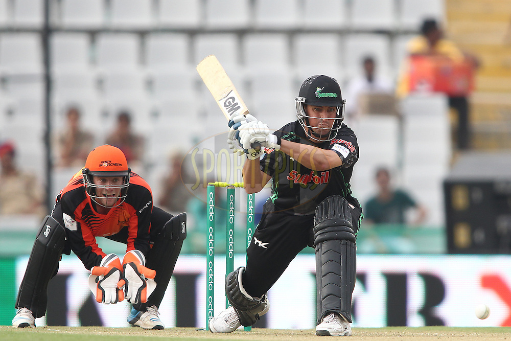 Daryn Smit of the Dolphins attempts to sweep a delivery during match 4 of the Oppo Champions League Twenty20 between the Dolphins and the Perth Scorchers held at the Punjab Cricket Association Stadium, Mohali, India on the 20th September 2014<br /> <br /> Photo by:  Shaun Roy / Sportzpics/ CLT20<br /> <br /> <br /> Image use is subject to the terms and conditions as laid out by the BCCI/ CLT20.  The terms and conditions can be downloaded here:<br /> <br /> http://sportzpics.photoshelter.com/gallery/CLT20-Image-Terms-and-Conditions-2014/G0000IfNJn535VPU/C0000QhhKadWcjYs