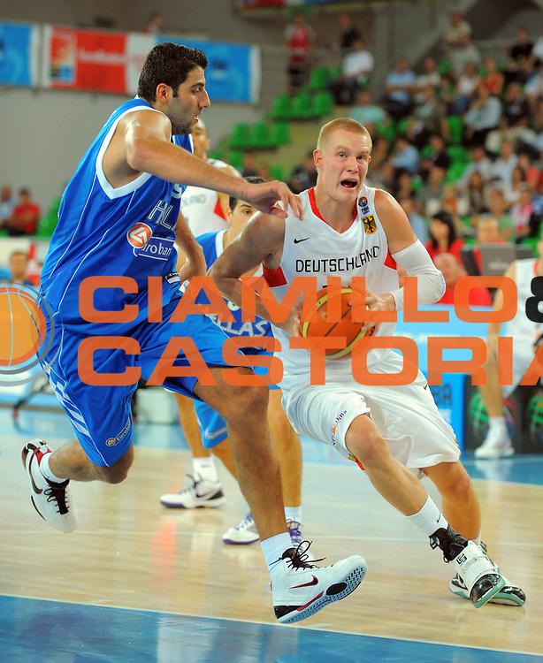 DESCRIZIONE : Bydgoszcz Poland Polonia Eurobasket Men 2009 Qualifying Round Germania Grecia Germany Greece<br /> GIOCATORE : Robin Benzing<br /> SQUADRA : Germania Germany<br /> EVENTO : Eurobasket Men 2009<br /> GARA : Germania Grecia Germany Greece<br /> DATA : 11/09/2009 <br /> CATEGORIA :<br /> SPORT : Pallacanestro <br /> AUTORE : Agenzia Ciamillo-Castoria/T.Wiedensohler<br /> Galleria : Eurobasket Men 2009 <br /> Fotonotizia : Bydgoszcz Poland Polonia Eurobasket Men 2009 Qualifying Round Germania Grecia Germany Greece<br /> Predefinita :