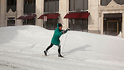 A woman skis Wednesday, Feb. 2, 2011, in  downtown Racine, Wi. The area got nearly two feet of snow. (AP Photo/Jeffrey Phelps)
