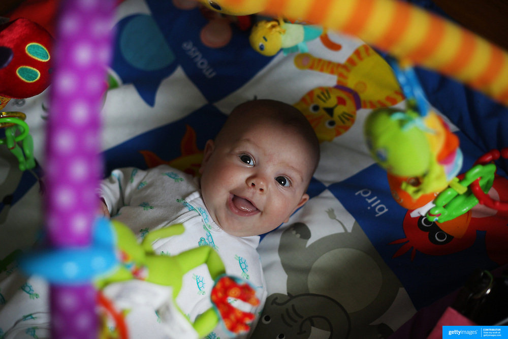 An four month old baby girl at play.  Photo Tim Clayton