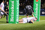 Cardiff Blues winger Owen Lane (14) crosses for a bonus try towards the end of  the Heineken Champions Cup match between Glasgow Warriors and Cardiff Blues at Scotstoun Stadium, Glasgow, Scotland on 13 January 2019.