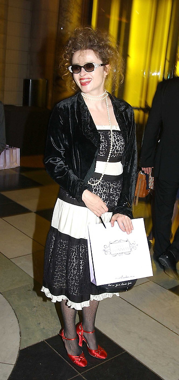 actress HELENA BONHAM-CARTER at a party to celebrate the publication of  'Put On Your Pearl Girls!' by Lulu Guinness held at the V&A museum, London on 5th May 2005.<br />